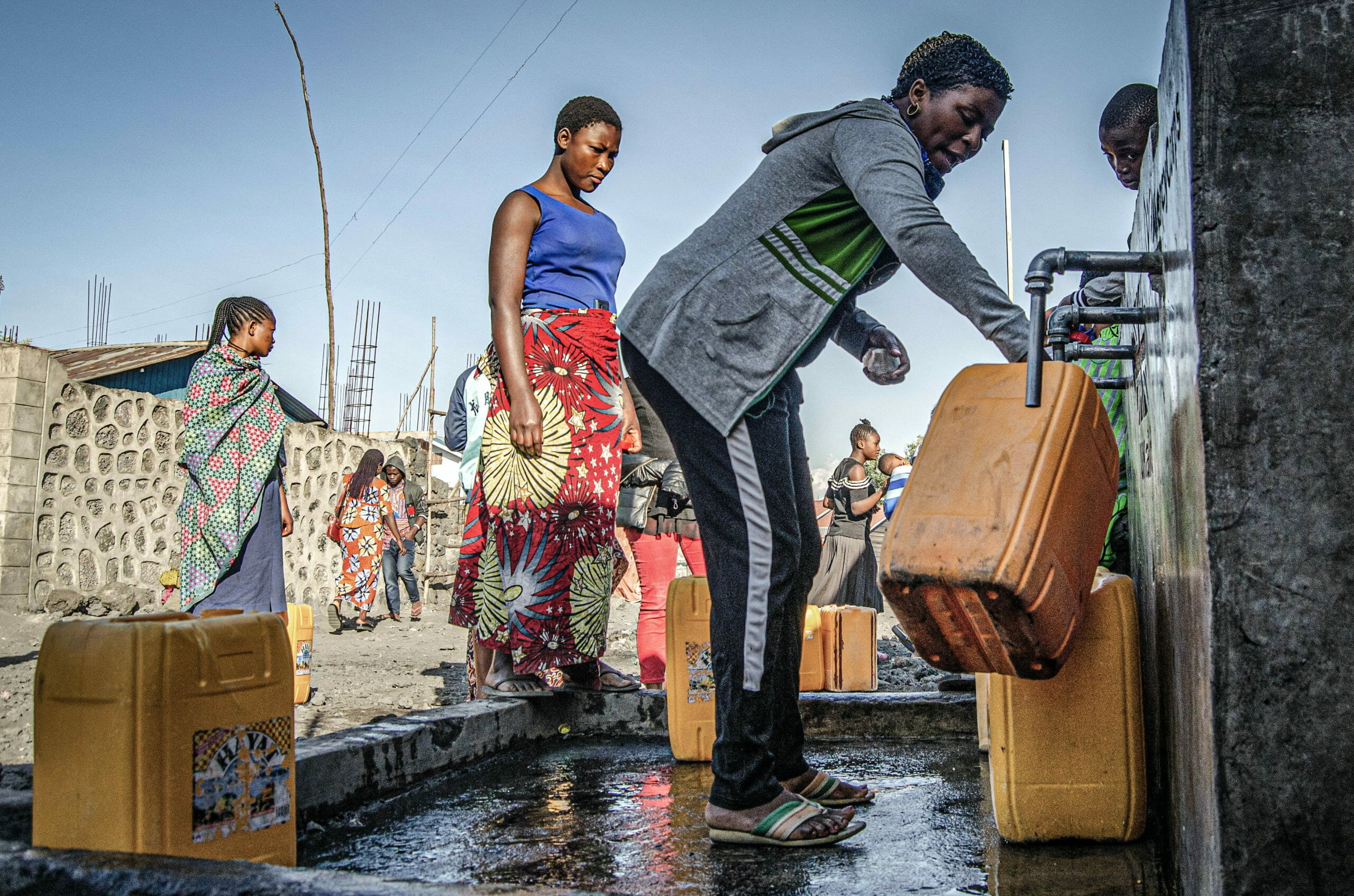 Goma, Democratic Republic of Congo, May 2020. A woman fills a water container in Goma, the capital of eastern Congo's North Kivu Province last month. © Arlette Bashizi for Fondation Carmignac