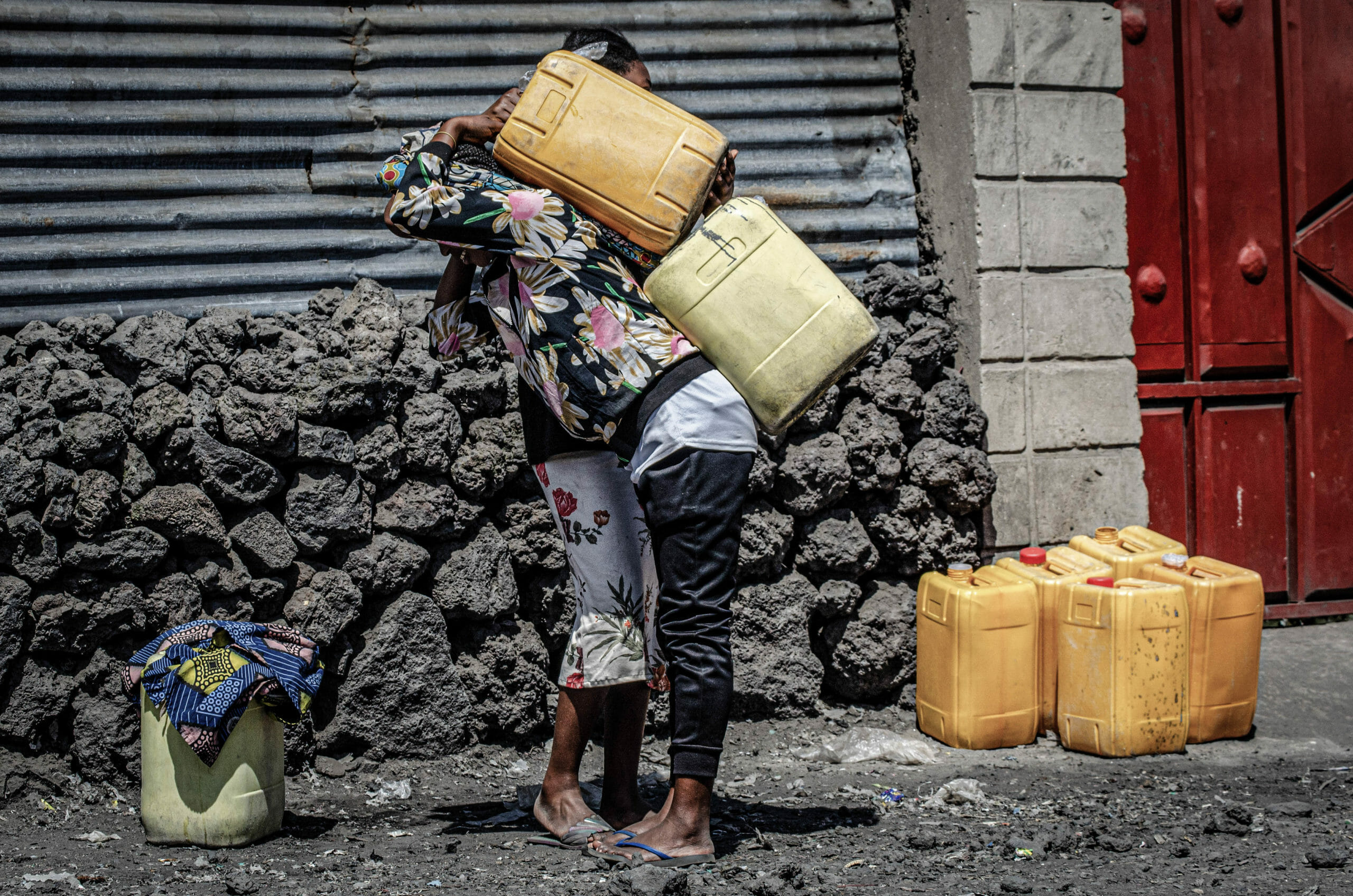 Goma, Democratic Republic of Congo, May 2020. A woman carries water containers in Goma, the capital of eastern Congo's North Kivu Province last month.© Arlette Bashizi for Fondation Carmignac