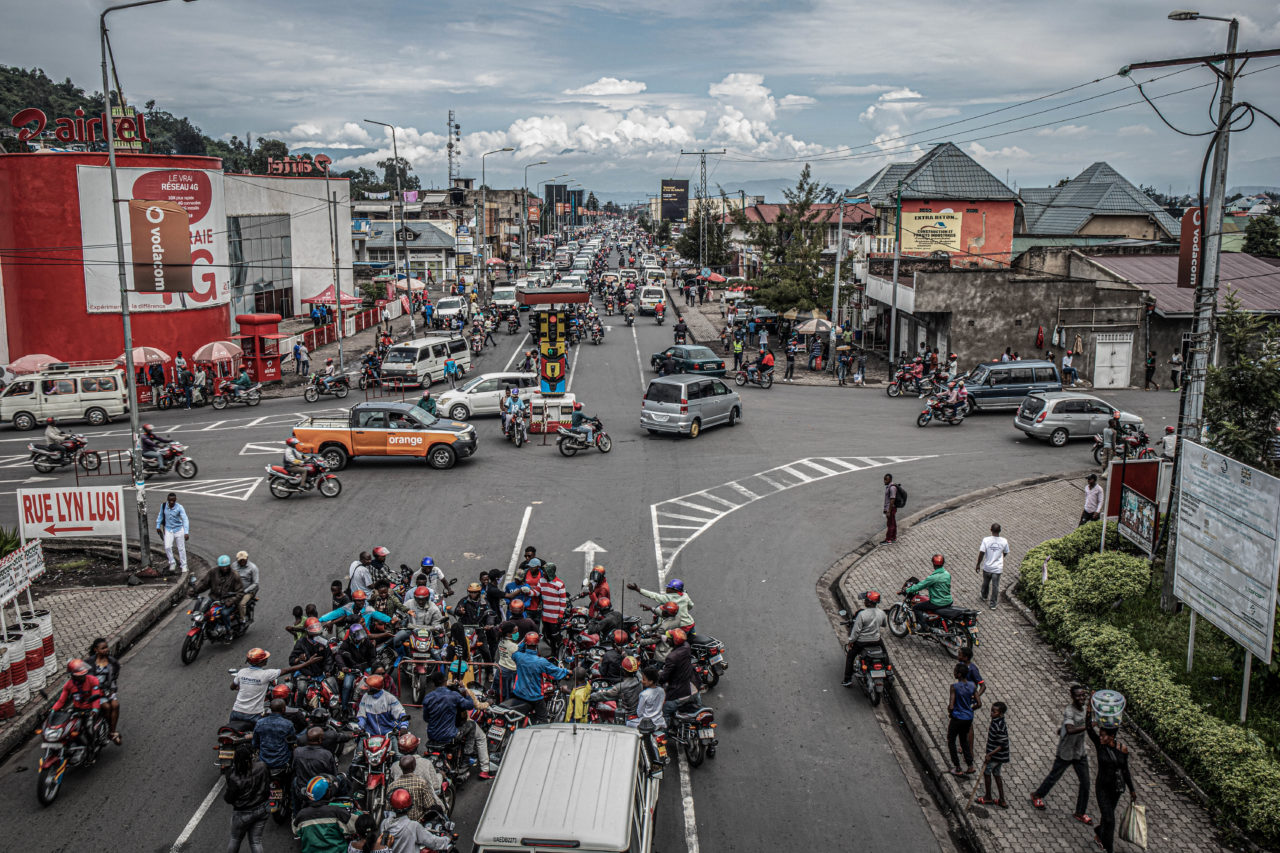 Goma, DRC, May 2020. Activists from the community collective Goma Actif provide masks to motorcycle taxi drivers at a downtown intersection in the eastern Congolese city of Goma in May. © Arlette Bashizi for Fondation Carmignac