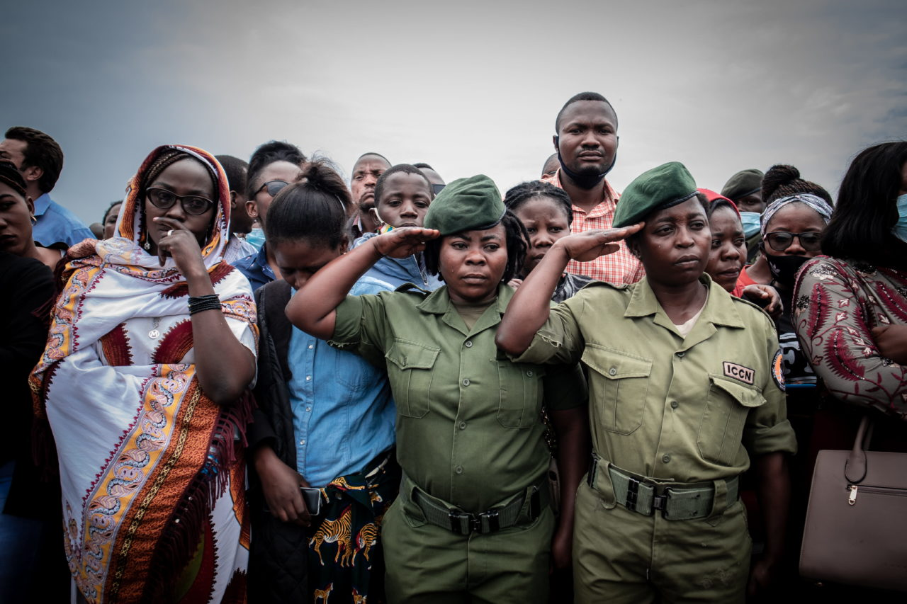 Goma, DRC, January 2021. Mourners attend the funeral of Eric Kibanja, one of six Virunga Park rangers killed in an ambush by armed attackers last month. The park has for years been the site of repeated attacks from rebels and militia groups, along with poachers and loggers, leading to the killing of hundreds of rangers. © Guerchom Ndebo for Fondation Carmignac
