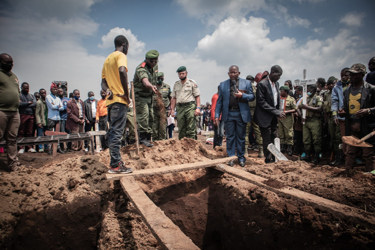 Virunga National Park, DRC, January 2021. Mourners attend the funeral of Eric Kibanja, one of six Virunga Park rangers killed in an ambush by armed attackers last month. The park has for years been the site of repeated attacks from rebels and militia groups, along with poachers and loggers, leading to the killing of hundreds of rangers. © Guerchom Ndebo for Fondation Carmignac