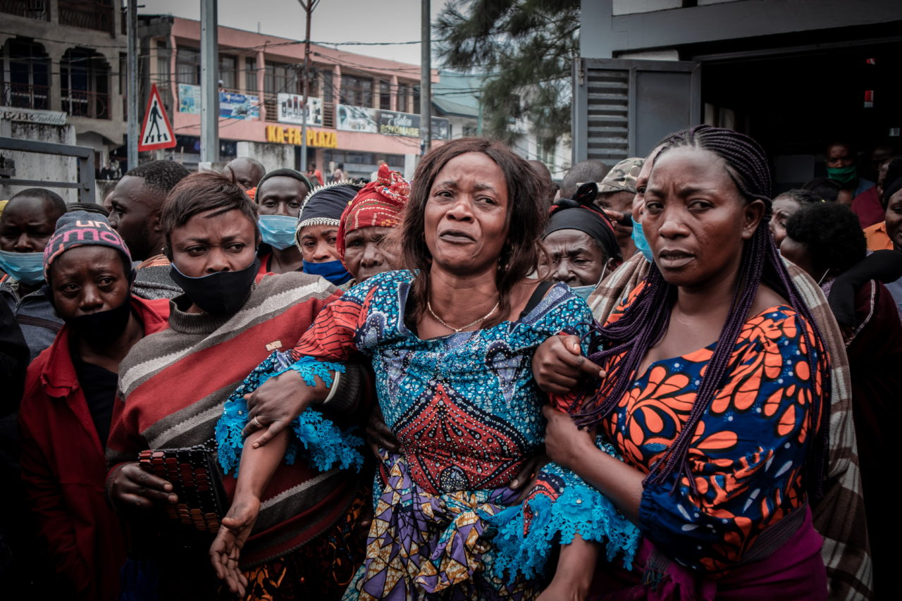 Goma, DRC, January 2021. Mourners in the eastern city of Goma attend the funeral of Eric Kibanja, one of six Virunga Park rangers killed in an ambush by armed attackers last month. © Guerchom Ndebo for Fondation Carmignac