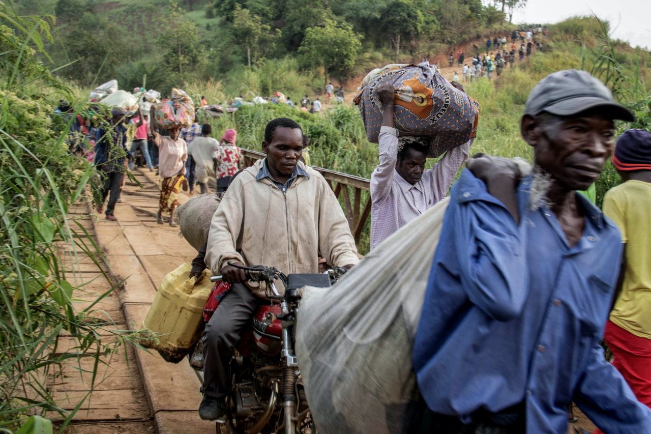 Northeastern Ituri Province, DRC, April 2020. People flee their villages toward the city of Bunia in Congo's northeastern Ituri Province after assailants from the Cooperative for the Development of Congo (CODECO), an armed political-religious sect drawn from the Lendu ethnic group, killed 22 members of the Hema community in the village of Koli in mid-April. Violence continues to force tens of thousands of Congolese to flee their homes in the eastern provinces of Ituri and North Kivu, where military operations, armed attacks and community tensions have driven conflict for years. In Ituri alone, the level of violence against civilians in the last month displaced about 200,000 people. With over 5 million internally displaced people, Congo hosts more than one tenth of the 50 million people internally displaced across the world, according to a 2019 report by the Internal Displacement Monitoring Centre. © Dieudonne Dirole for Fondation Carmignac
