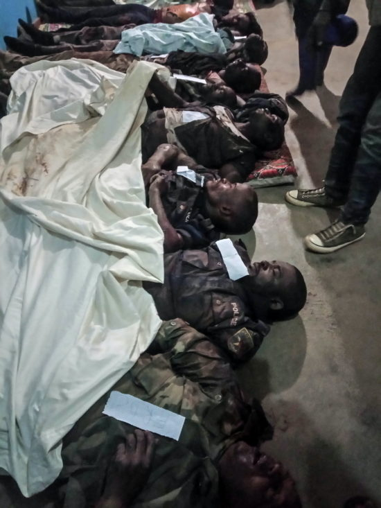"""Bunia, DRC, July 2020. The bodies of three Congolese policemen and four government soldiers lie at the morgue in the city of Bunia in Congo's northeastern Ituri Province after 11 people, including a provincial deputy and civilians, were killed by gunmen in an ambush at the village of Matete in Djugu territory on July 4. The attack was the latest blamed on assailants from the Cooperative for the Development of Congo (CODECO), an armed political-religious sect drawn from the Lendu ethnic group that has targeted rival members of the Hema community. CODECO and other Lendu fighters are accused by The Office of the UN High Commissioner for Human Rights of pursuing """"a strategy of slaughtering local residents—mainly the Hema, but also the Alur—since 2017"""" to control natural resources in the region. Militia attacks have killed at least 444 civilians in Ituri since March and displaced more than 200,000 people since the beginning of the year, according Human Rights Watch, which cited United Nations sources. © Dieudonne Dirole for Fondation Carmignac"""