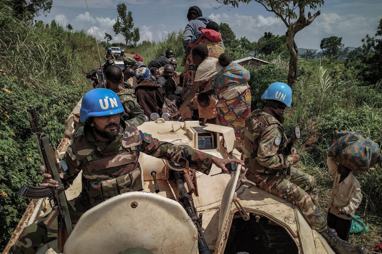 Blukwa, DRC, June 2019. UN peacekeepers assist civilians during the evacuation of the village of Blukwa in Ituri last year after a series of massacres in Djugu territory killed 161 people in early June 2019. © From the archive of Dieudonne Dirole for Fondation Carmignac