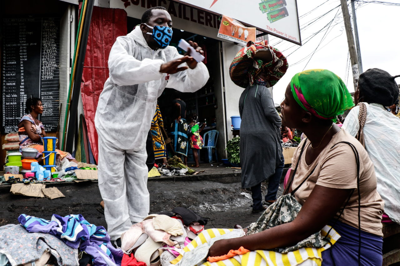Kinshasa, DRC, May 2020. A member of the pro-democracy and civil society movement Filimbi carries out a public educational campaign about coronavirus in a market in Congo's capital Kinshasa in May. © Justin Makangara for Fondation Carmignac