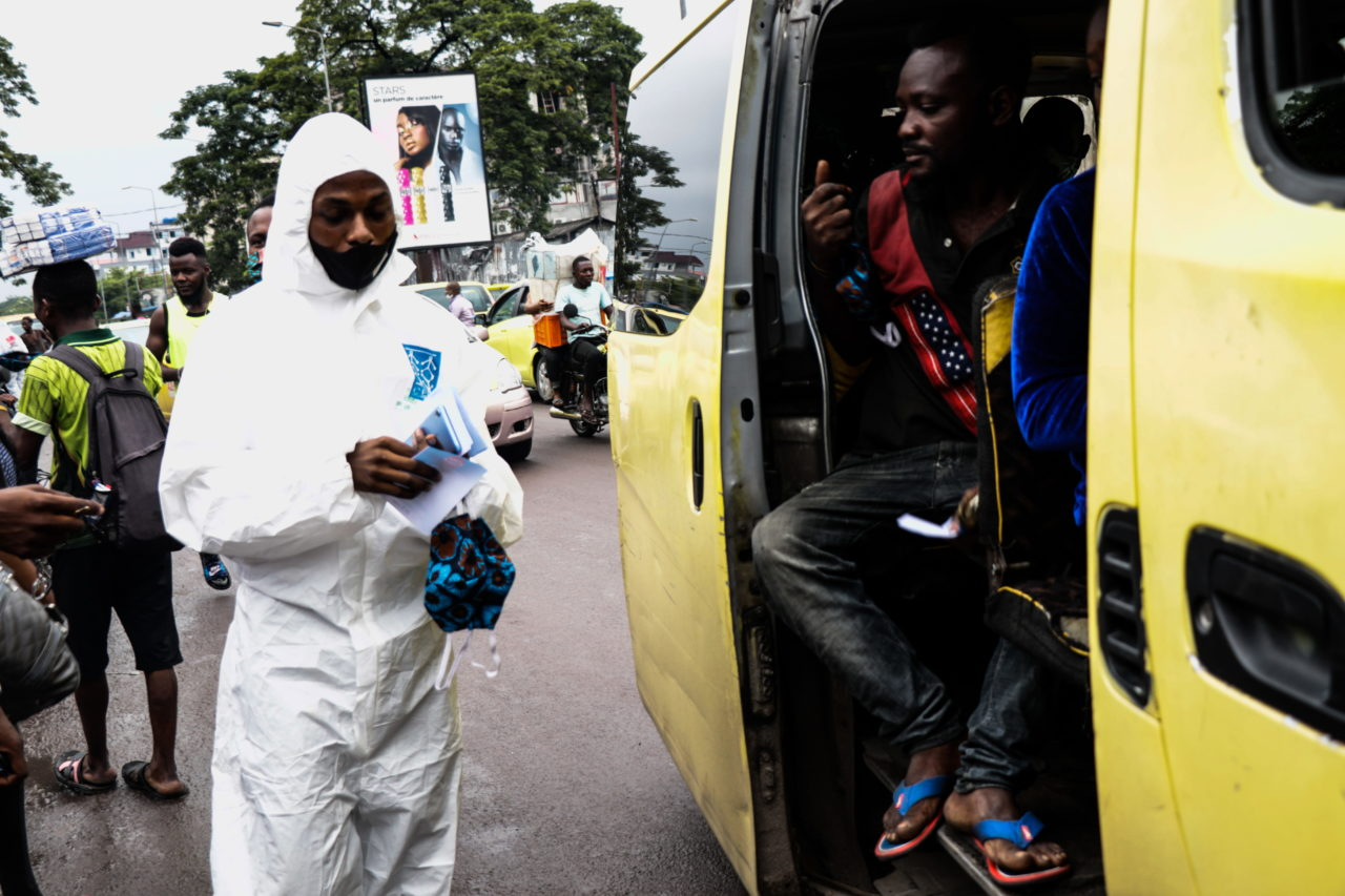 Kinshasa, DRC, May 2020. A member of the pro-democracy and civil society movement Filimbi carries out a public educational campaign about coronavirus in Congo's capital Kinshasa in May. © Justin Makangara for Fondation Carmignac