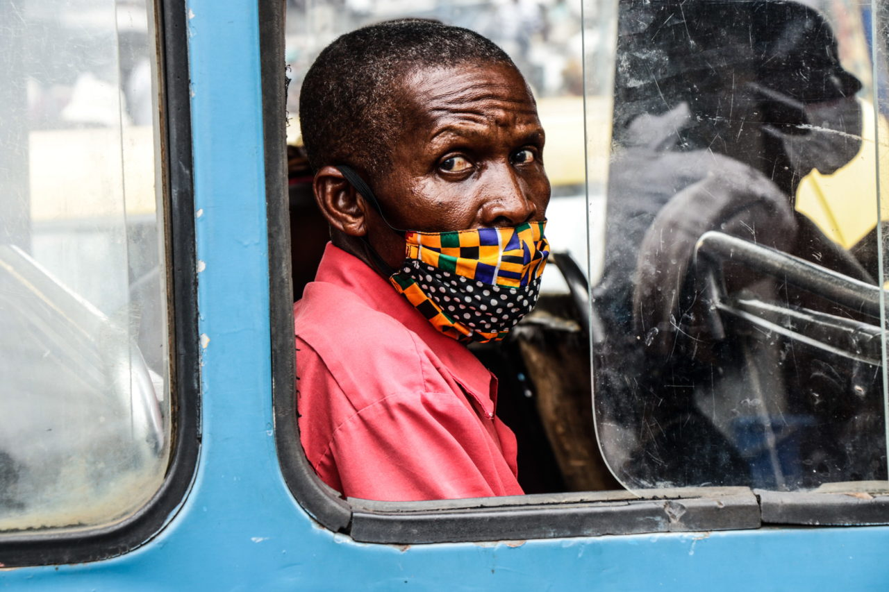 Kinshasa, DRC, May 2020. A passenger on a minibus taxi wears a mask in Congo's capital Kinshasa in May. © Justin Makangara for Fondation Carmignac