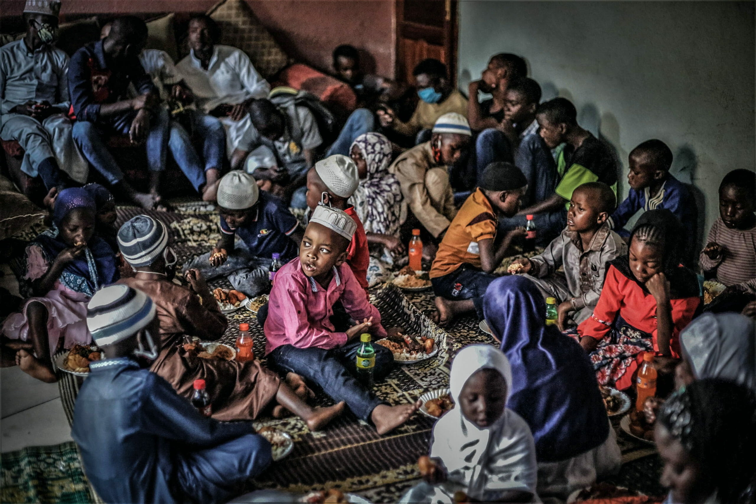 Goma, DRC, May 2020. Vulnerable children gather for a shared meal at a muslim community centre in Goma during Ramadan last week. © Ley Uwera for Fondation Carmignac