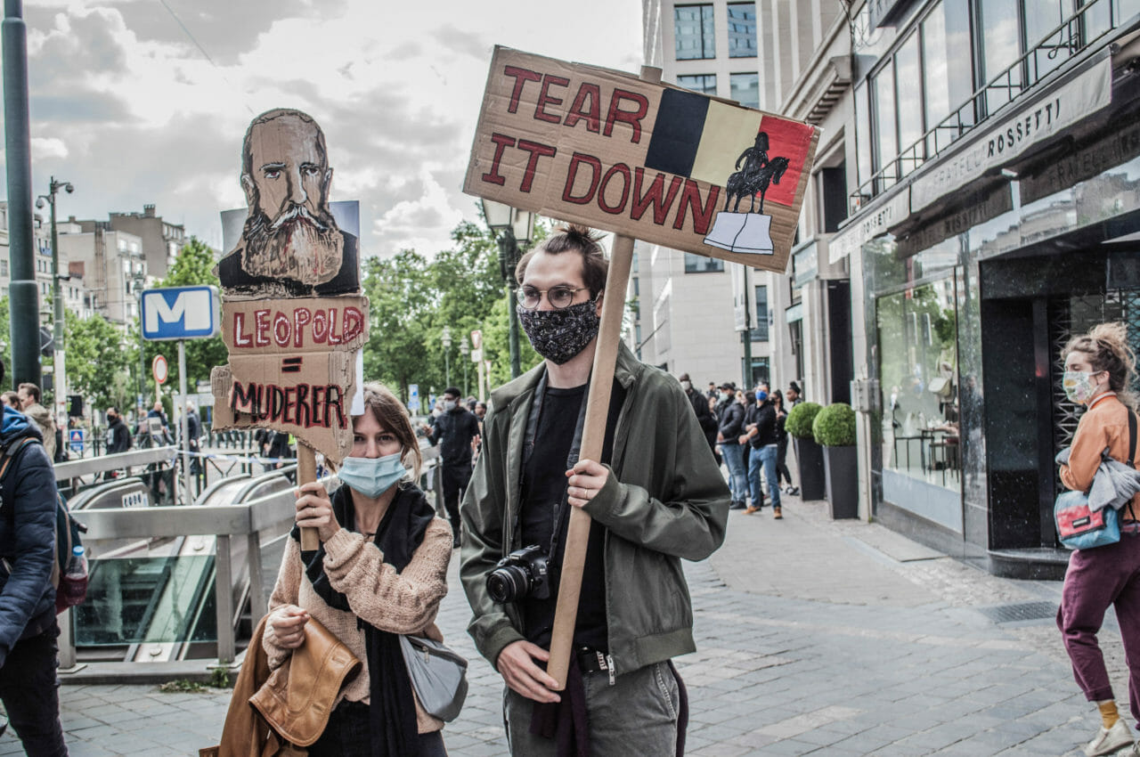 Brussels, Belgium, June 6-7, 2020. Protesters at a Black Lives Matter rally in Brussels this weekend, where some protesters denounced Belgium's imperial exploitation of what is now the Democratic Republic of Congo. As Europe grapples with its own race issues alongside the Black Lives Matter movement in America, monuments and statues to King Leopold were vandalized in cities across Belgium last week. A crowd climbed on one statue in Brussels over the weekend and waved the Congolese flag while chanting 'murderer' and 'reparations.' The movement is gaining traction with more than 60,000 people signing a petition calling for the removal of all King Leopold statues. © Pamela Tulizo for Fondation Carmignac