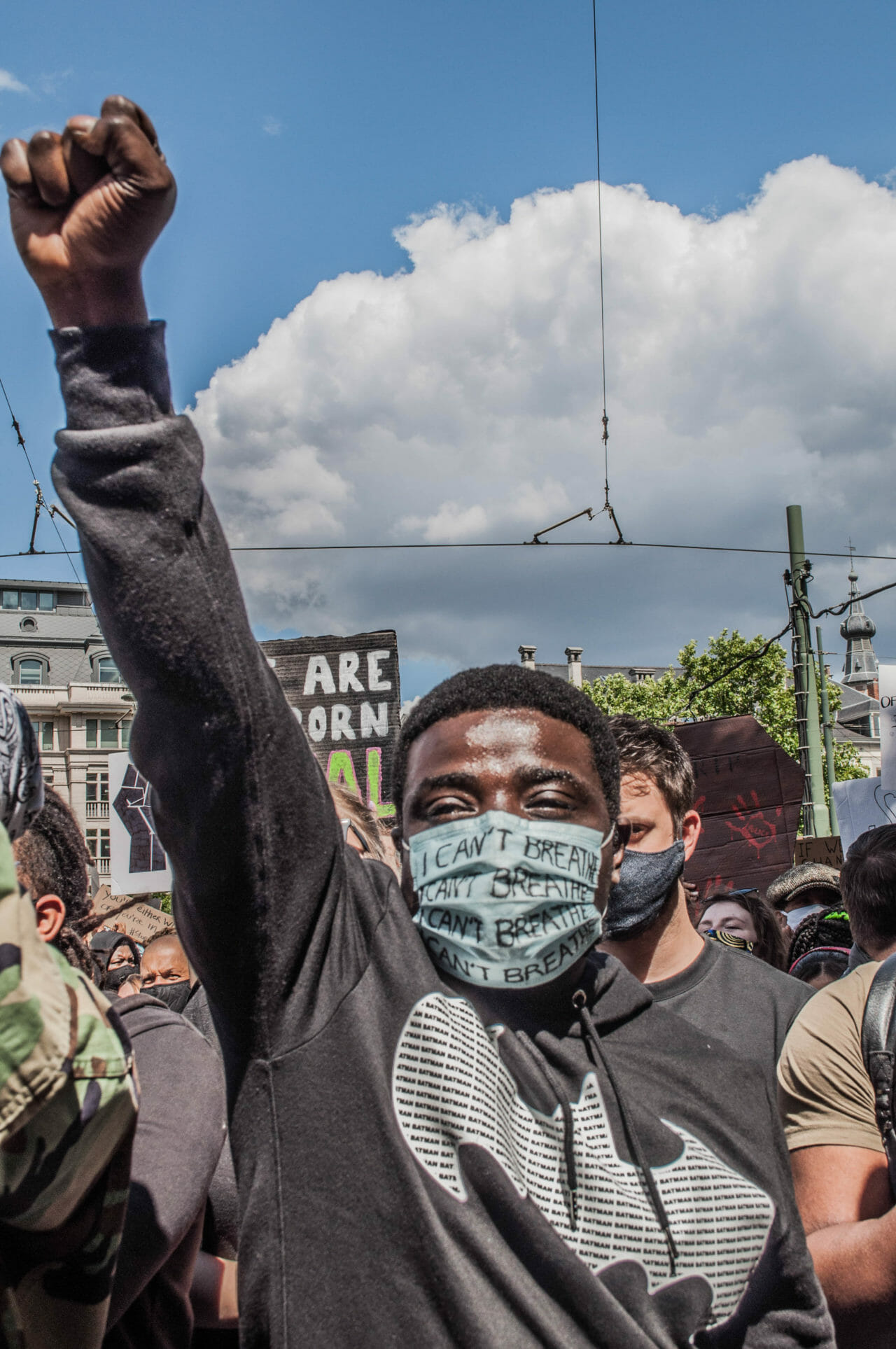 Brussels, Belgium, June 6-7, 2020. A Congolese protestor gives the Black Power salute at a Black Lives Matter rally in Brussels this weekend, where some protesters denounced Belgium's imperial exploitation of what is now the Democratic Republic of Congo. As massive gatherings for racial justice gain momentum around the world, activists in Belgium are hoping the global movement may finally shift attitudes toward the colonial legacy of King Leopold II, the monarch whose tyrannical rule over the Congo Free State (now the Democratic Republic of Congo) is blamed for the deaths of between 10-15 million Congolese. © Pamela Tulizo for Fondation Carmignac