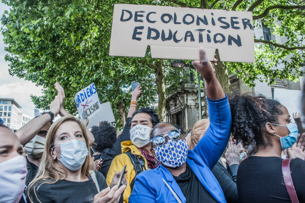 Brussels, Belgium, June 6-7, 2020. A Congolese woman at a Black Lives Matter rally in Brussels this weekend, where some protesters denounced Belgium's imperial exploitation of what is now the Democratic Republic of Congo. Belgium's history of imperial exploitation does not feature strongly in the country's educational curriculum or in public discourse, and King Leopold is generally celebrated for bringing civilization, welfare, and culture to Congo. © Pamela Tulizo for Fondation Carmignac