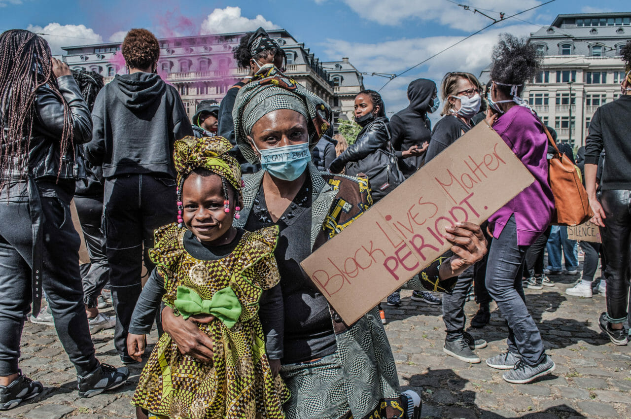 Brussels, Belgium, June 6-7, 2020. A Congolese woman at a Black Lives Matter rally in Brussels this weekend, where some protesters denounced Belgium's imperial exploitation of what is now the Democratic Republic of Congo. As massive gatherings for racial justice gain momentum around the world, activists in Belgium are hoping the global movement may finally shift attitudes toward the colonial legacy of King Leopold II, the monarch whose tyrannical rule over the Congo Free State (now the Democratic Republic of Congo) is blamed for the deaths of between 10-15 million Congolese. © Pamela Tulizo for Fondation Carmignac