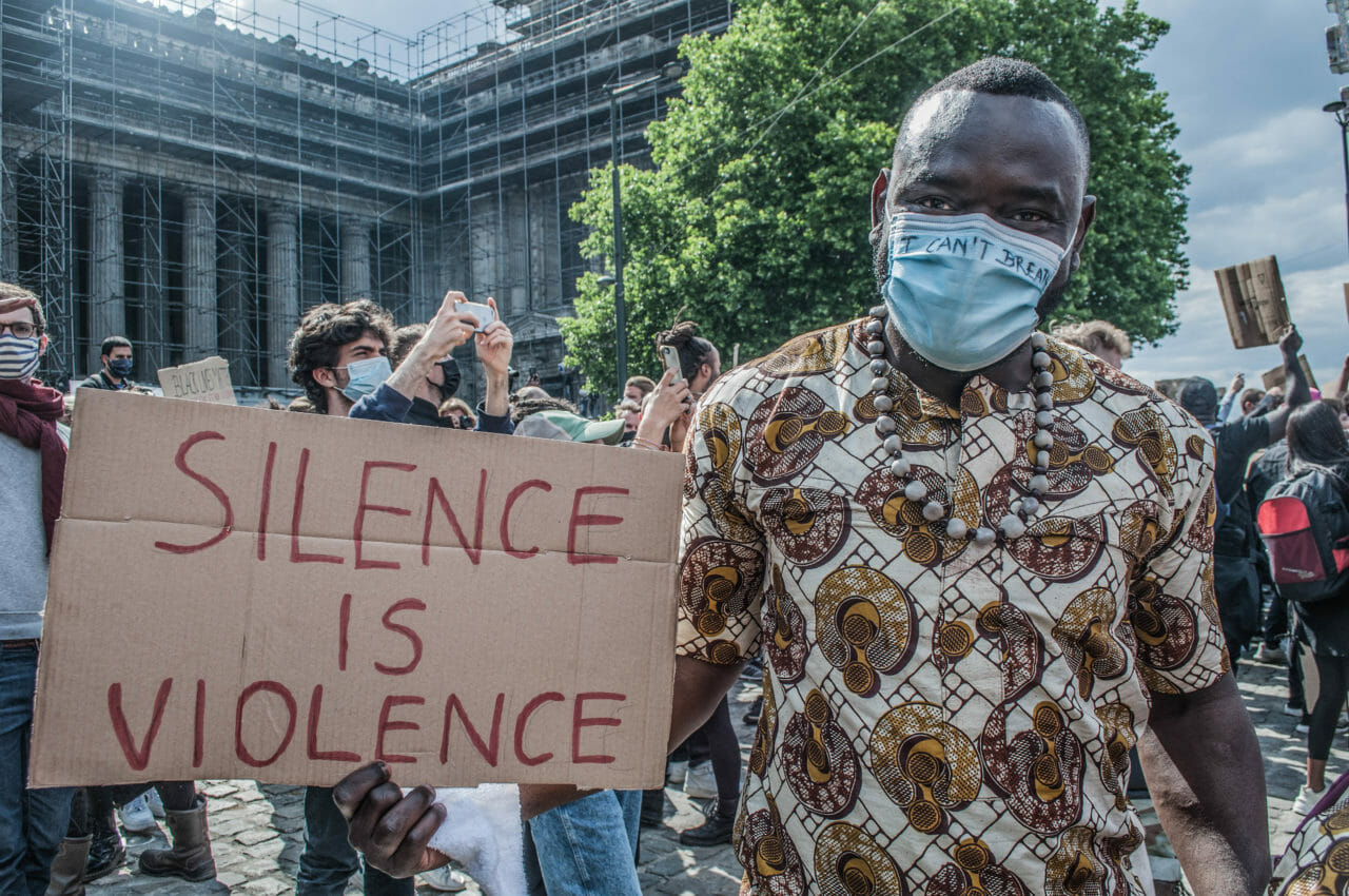 Brussels, Belgium, June 6-7, 2020. A Congolese man at a Black Lives Matter rally in Brussels this weekend, where some protesters denounced Belgium's imperial exploitation of what is now the Democratic Republic of Congo. As massive gatherings for racial justice gain momentum around the world, activists in Belgium are hoping the global movement may finally shift attitudes toward the colonial legacy of King Leopold II, the monarch whose tyrannical rule over the Congo Free State (now the Democratic Republic of Congo) is blamed for the deaths of between 10-15 million Congolese. © Pamela Tulizo for Fondation Carmignac