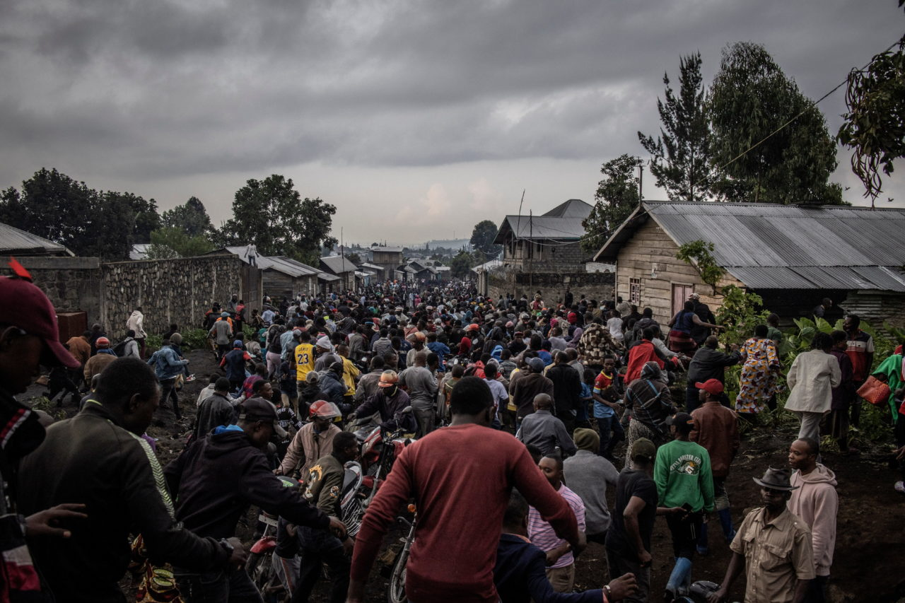 People flee in a moment of panic as an aftershock hits the neighbourhood of Buhene the morning after the eruption. Finbarr O'Reilly for Fondation Carmignac