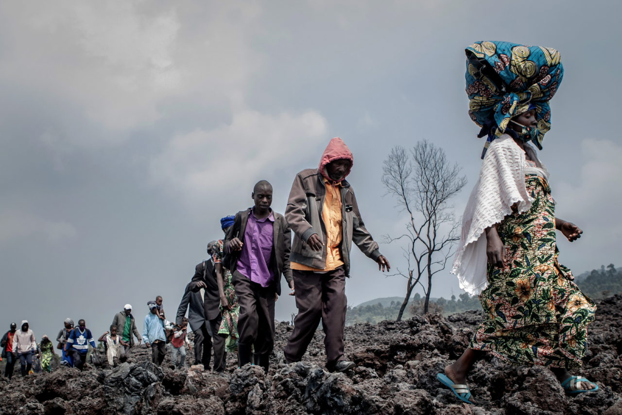 People cross the cooling lava flow in search of a safe place to stay after the eruption. Guerchom Ndebo for Fondation Carmignac