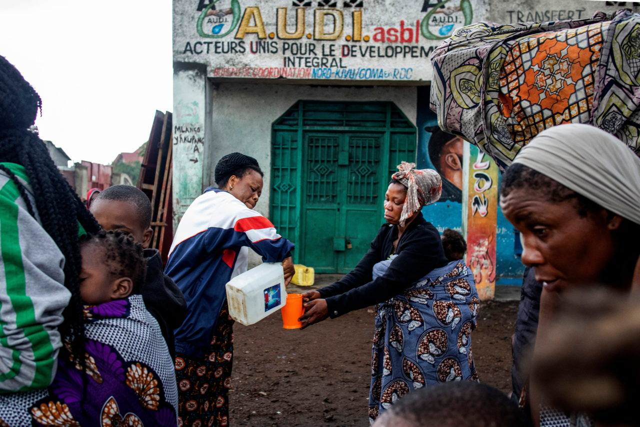 A woman is given water as people flee town on the morning after the eruption. Arlette Bashizi for Fondation Carmignac