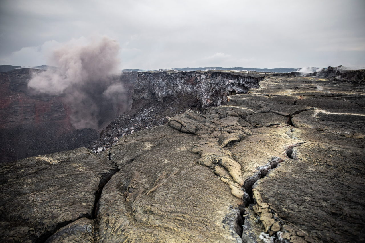 Smoke, fumes, and dust from a rockfall (left) inside the crater of Mount Nyamulagira in eastern Democratic of Congo on Sunday May 30, eight days after the eruption of the adjacent Mount Nyiragongo forced the evacuation of much of the nearby city of Goma and left left 32 people dead and 20,000 homeless. Finbarr O'Reilly for Fondation Carmignac