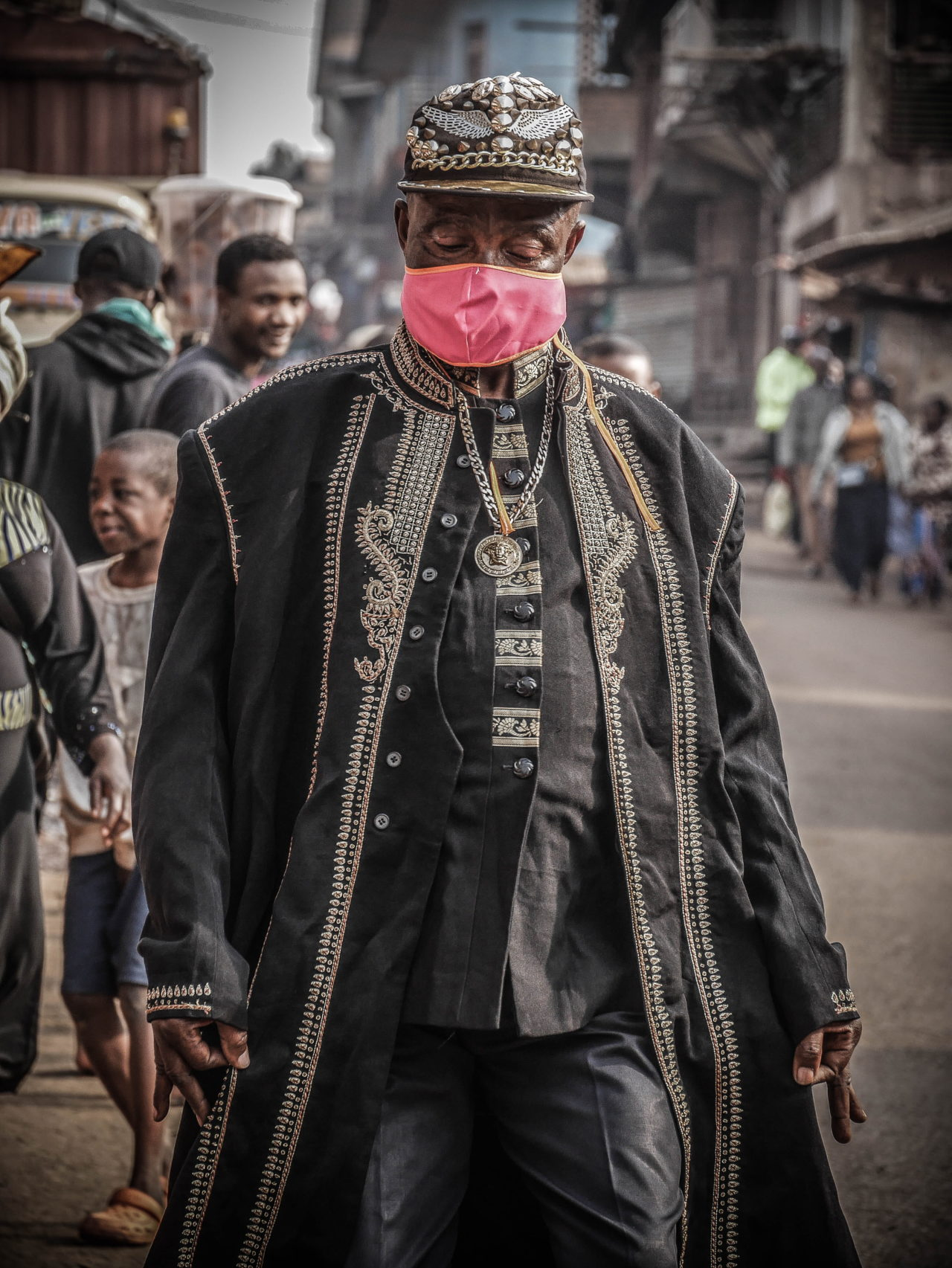 Bukavu, DRC, August 2020 Sapeur Delphin Kalita Mambo, 61, who goes by the name Niarcos Kalita, shows off his style on a street in Bukavu this month.  Raissa Karama Rwizibuka for Fondation Carmignac