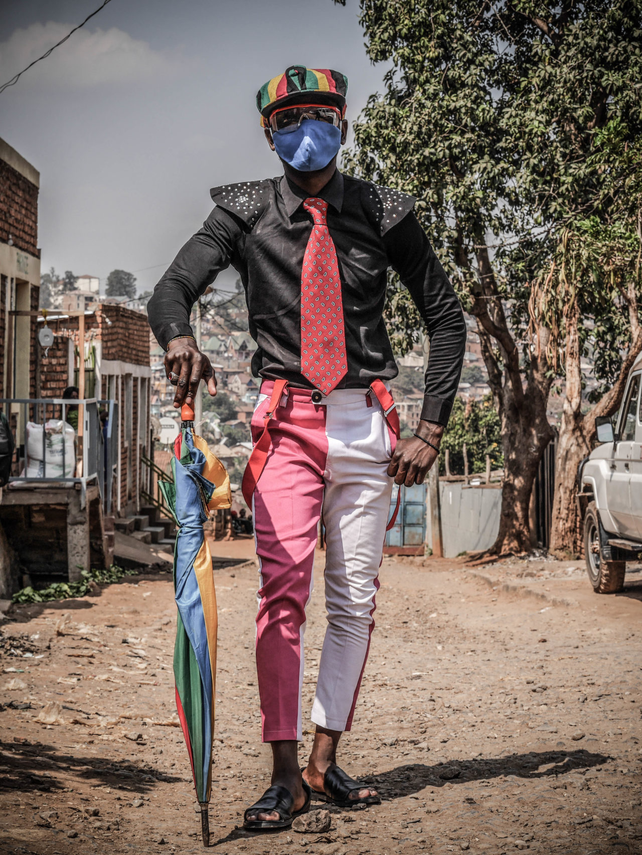 Bukavu, DRC, August 2020 Sapeur Chrispin Floribert Sumaili, 25, shows off his style on a street in the eastern Congolese city of Bukavu this month.  Raissa Karama Rwizibuka for Fondation Carmignac